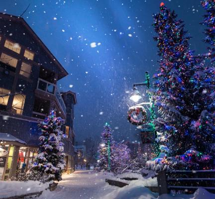Building exterior at night with snow and Christmas decorations