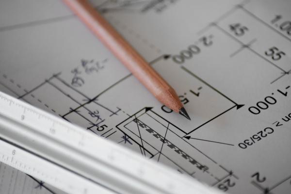 Architectural plans with pencil