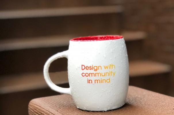 "Mug that says ""design with community in mind"""