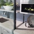 The New American Home 2019_indoor/outdoor kitchen_detail_countertop_telescoping patio door