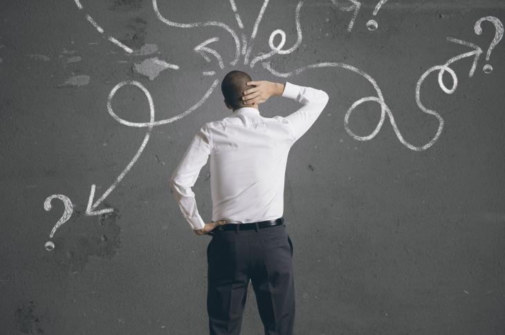 solve sales and marketing problem_identify problem_Man at chalkboard, scratching head (Photo: alphaspirit / 123RF)