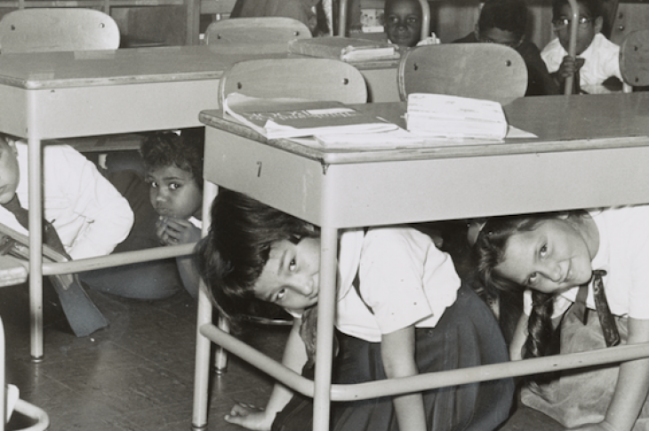 Nuclear attack drill, kids under desks