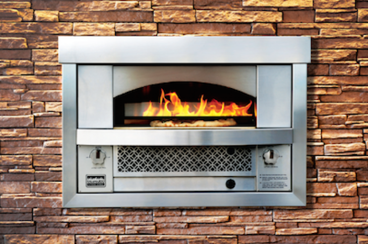 Kalamazoo Outdoor Gourmet released a new version of its Artisan Fire Pizza Oven, a wall-set oven.