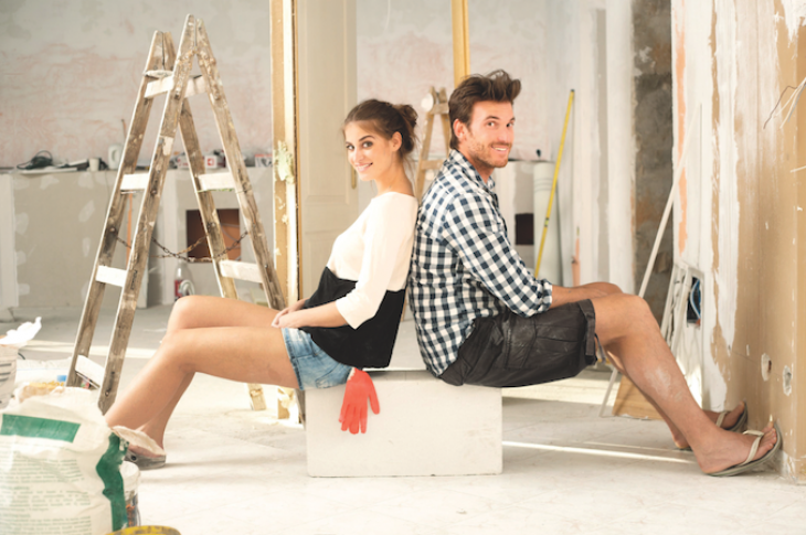 how satisfied are new homebuyers-couple sits in unfinished home