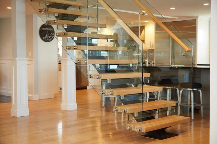 Flight by Viewrail floating stairs are customizable with steel stringers, 15 species of wood treads with thicknesses up to 4 inches, unobtrusive brackets, and railings of cable, glass (shown), or stainless steel.