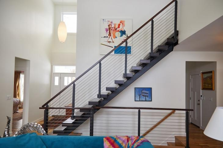 Viewrail FLIGHT floating stairs open up a space that is normally encased in drywall.