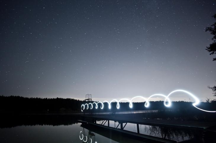 Light streaks over a lake