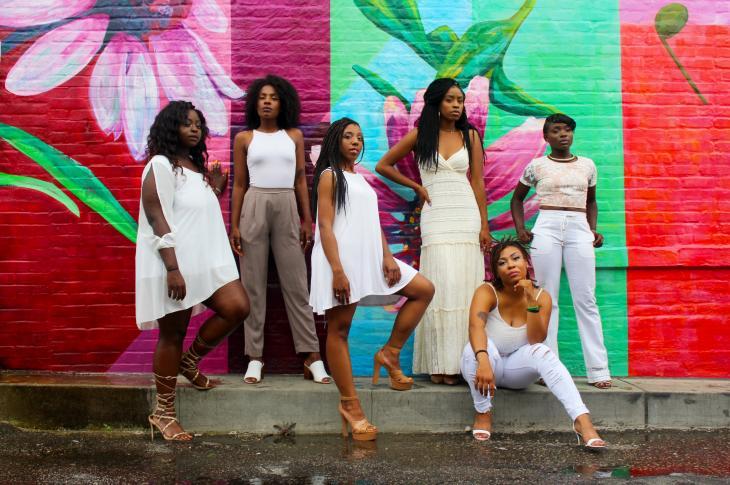Women standing in front of mural in Minneapolis