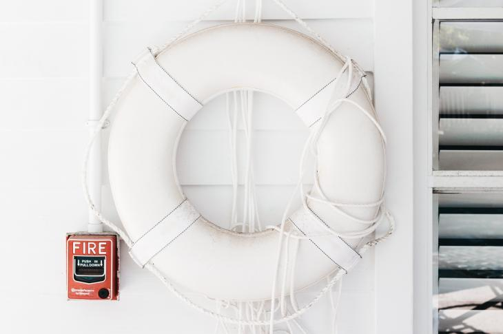 Lifesaver hung on a white wall