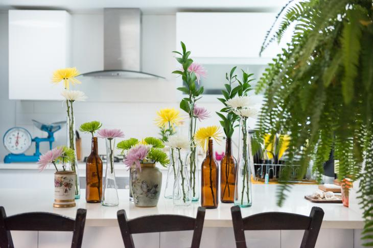 Kitchen with flowers in vases on table