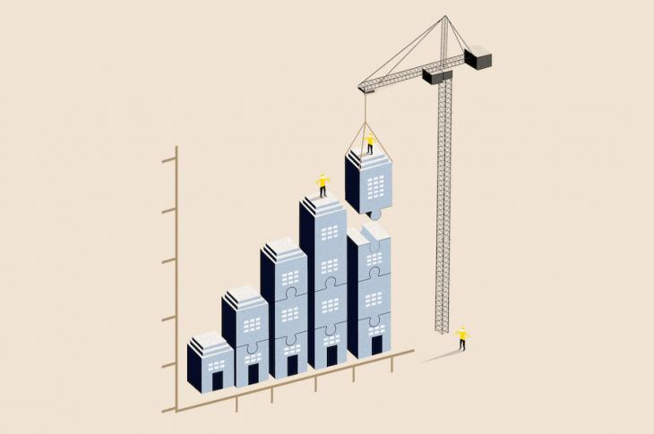 Illustration of crane building a bar chart composed of house blocks