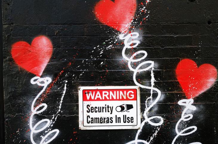 Warning sign with graffiti
