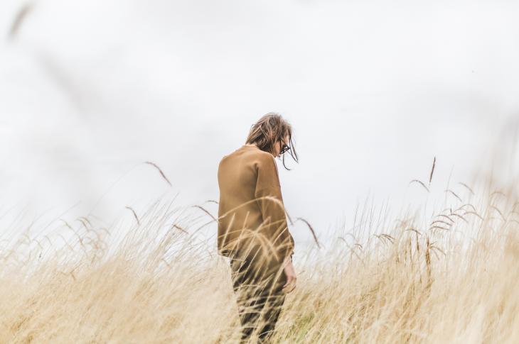 girl looking away in field