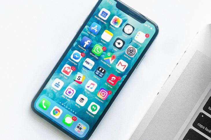 iPhone with apps on screen