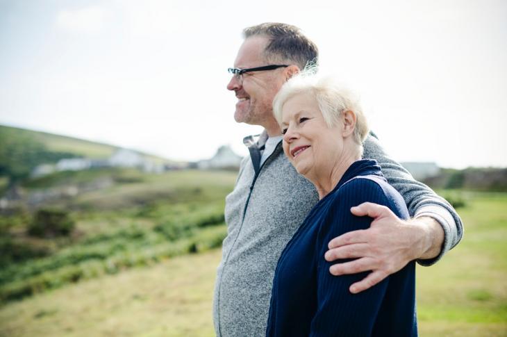 Senior couple in green field