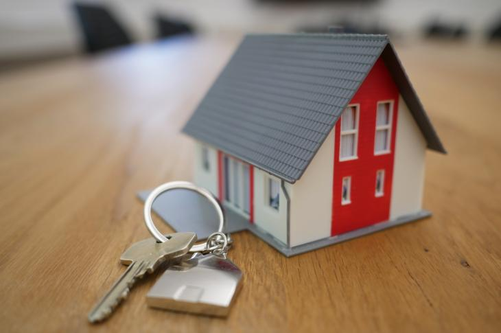 Model house and keys for new homeowners
