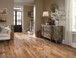 The Antigua Collection from Mannington Mills, utilizes 3-, 5-, and 7-inch random width boards and a hand scraping technique to evoke a rustic look.