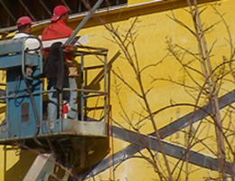 Construction workers in aerial lift