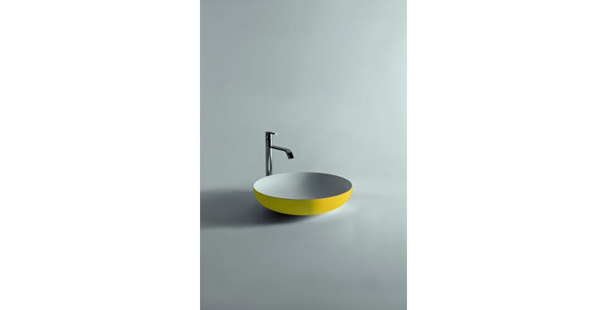 Flumood, a new collection of top-mount solid surfacing sink in yellow