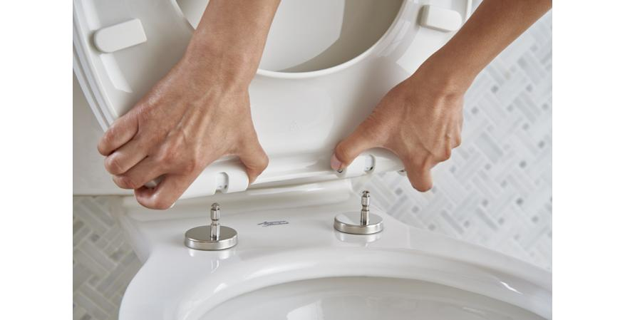 American Standard ActiClean SuiteSbhot removing self cleaning toilet seat.