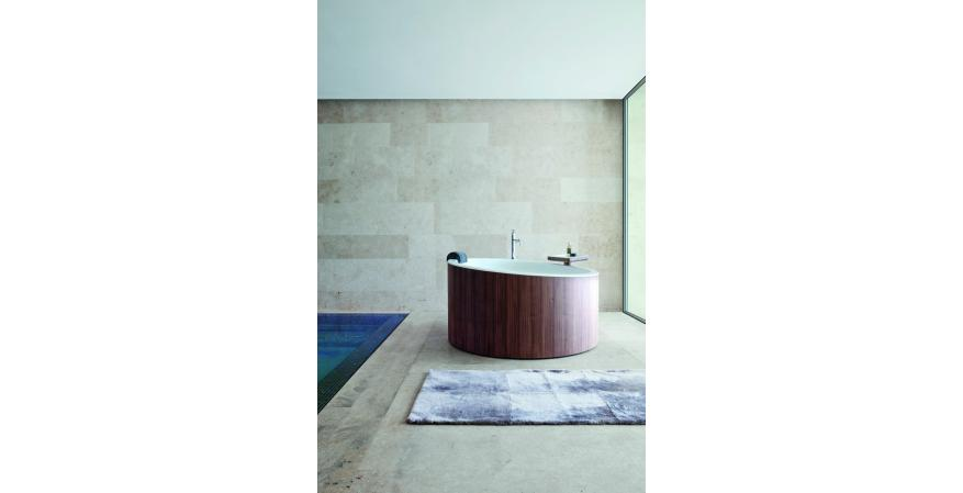 Nespoli and Novara Design Studio created Graff's Dressage tub for maximum relaxation. An angled tub deck accommodates stretching and a 4-5/16-inch diameter ensures plenty of sitting room. The minimalist design conceals all plumbing and contrasts a white Corian interior with a walnut exterior
