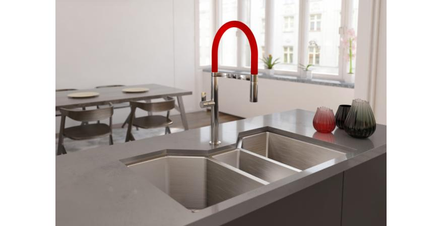 Made from stainless steel, the Ibiza faucet measures 20 inches tall with a spout reach of 9 inches. The flexible spout also pulls down to access the far corners of the sink. In ruby red.