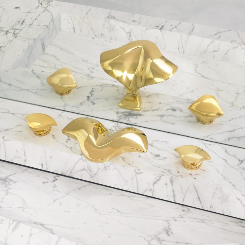 Gold-colored faucets from Alex Miller Studio