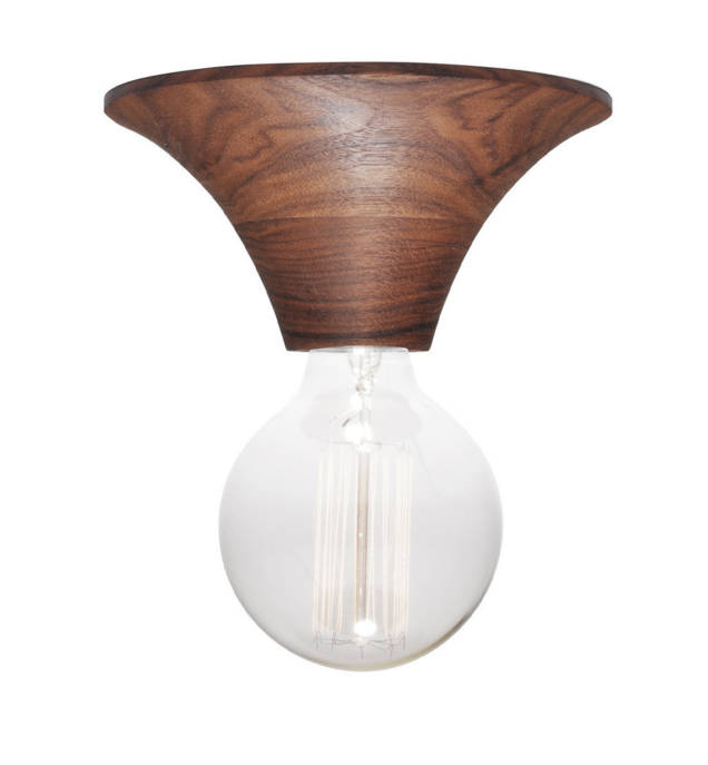 The Good Flock is known for crafting American-made consumer goods, but the company also produces a line of unique lighting for hardwired applications. Each lamp features a hand-turned wood base, a porcelain socket, and stainless steel and brass hardware. Made from black oak, ash, and walnut, each light measures 6.5 inches by 3 inches and is fitted with an easy-to-install flush mount bracket.