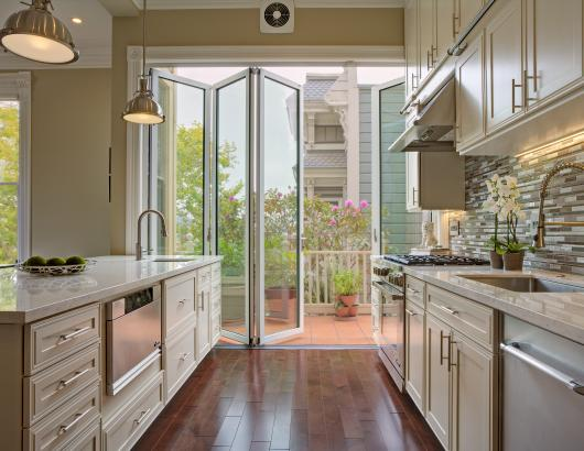 Painted Lady Queen Anne Victorian with NanaWall in kitchen