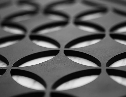 A black grille from AJK Design Studio with a Moroccan pattern for AC registers.