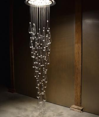 Inspired by rain showers, the Raindrop chandelier features five canopy-mounted 4-watt LED lights, 60 glass raindrops that hang from stainless steel cables, and a dome-shaped, canopy made from spun aluminum.