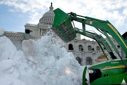 Snow removal operations taking place in front of the U.S. Capitol in Washington, D.C.