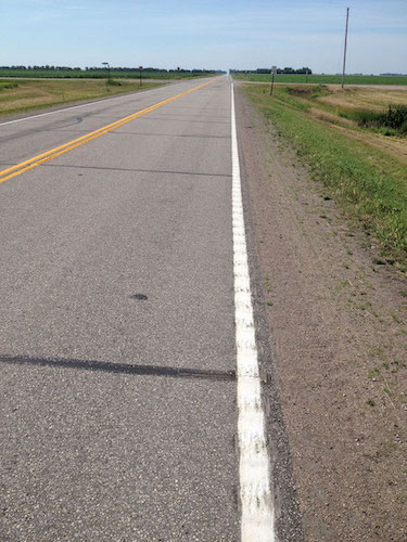 A hybrid rumble strip design includes a 6-in. pavement marking with 4 in. of painted grooving and an additional 2 in. of grooving outside the painted edge line.