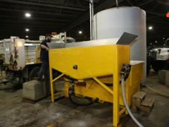 Workers in Wisconsin load the briner maker.
