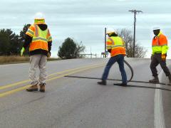 N-Line crew installs an array of RoadQuake 2F Folding Temporary Portable Rumble Strips.