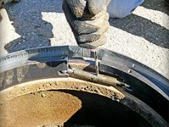 "American Highway's ""Pivoted Turnbuckle"" manhole riser"