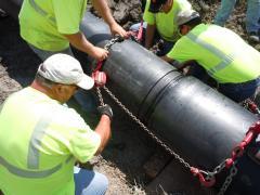 South Dakota DOT maintenance crew relines old culverts