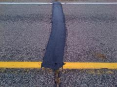 A close-up view of Mastic One applied to a transverse crack on County Road 13 in Nicollet County, Minn.