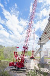 A Dawes crane lifts a steel beam on the base of the Baraboo bypass