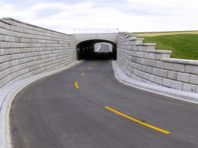 Redi-Rock retaining walls were used to provide structural support for the security access road rerouted beneath the runway at the Louisville International Airport.