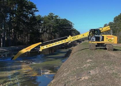 Boom extension helps clear Texas canals