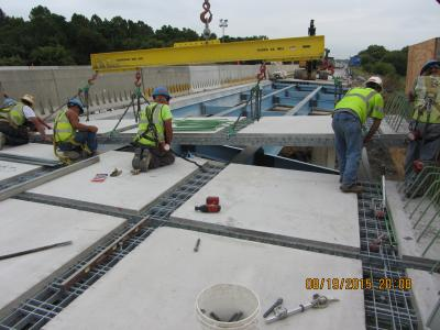 Rigid lifting frame used to place precast grid panels