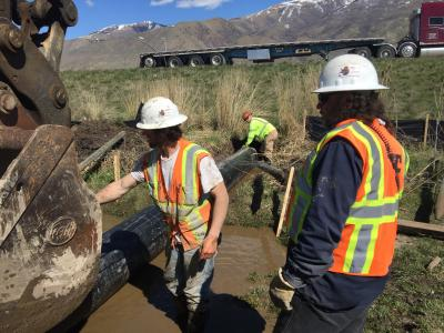 Pipe sliding through existing culvert done without diverting roadway traffic