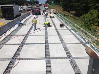 Precast deck panels set in place.