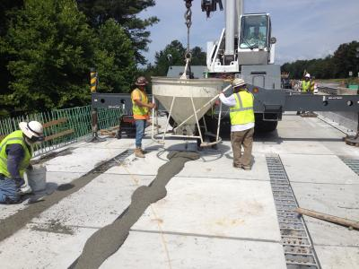 A pour on the grid deck for closure.