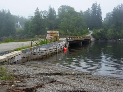 The goal was to rebuild a deteriorating bridge that provided access to four seasonal homes and was an important wharf for the local lobster industry.