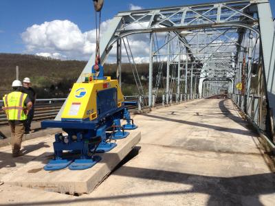 Removing concrete from bridge deck using a Vacuworx RC 10 with Octapad System