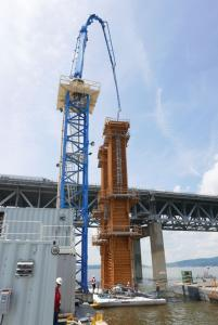 Crews place one of the nearly 7,000 precast concrete deck panels for the main and approach spans.