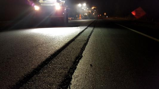 Paving crews worked the inside lanes at night utilizing the notched wedge joint on the shoulder lane.
