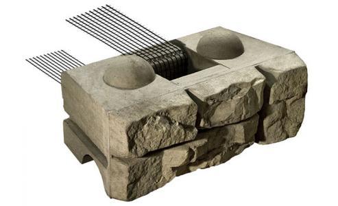 Positive connection concrete blocks reinforced retaining walls